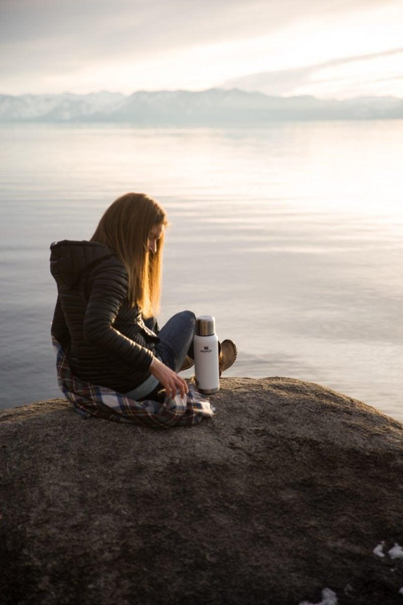 Julia Mueller at Lake Tahoe on a rock