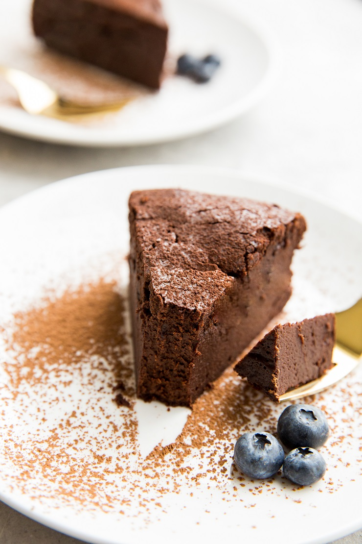 Rich and delicious Flourless Keto Chocolate Cake Recipe made with basic ingredients. Dairy-free, gluten-free, absolutely delicious!