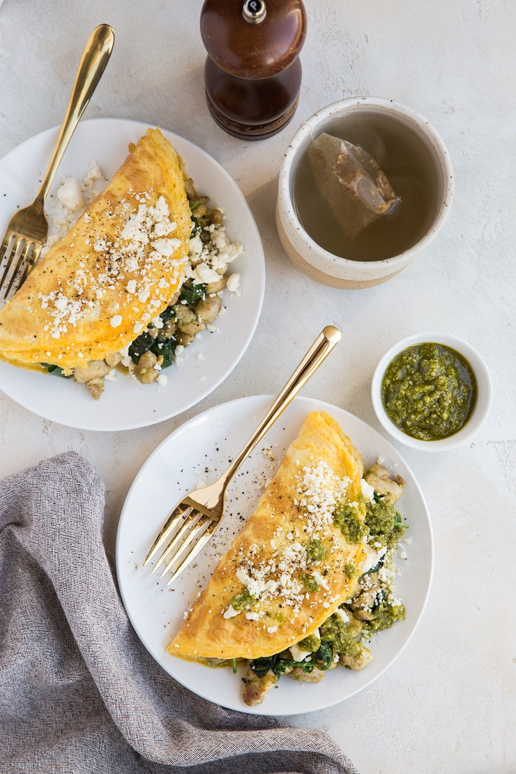 Pesto Chicken Omelettes with feta cheese and spinach are an amazing breakfast that's so easy to make