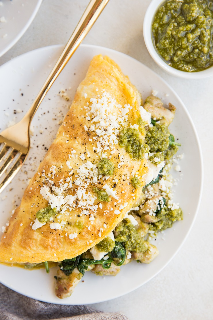Easy Chicken Omelette with pesto sauce, spinach, and feta cheese. Nutritious and delicious!
