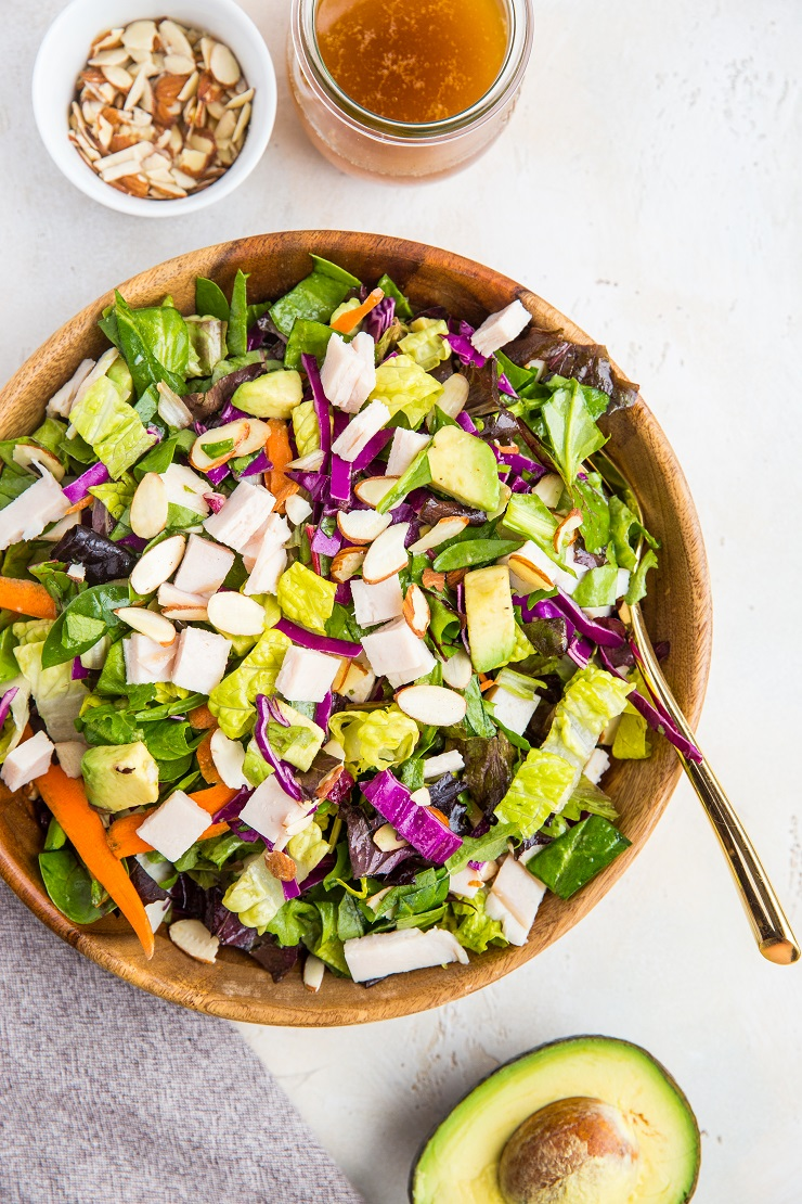Sesame Turkey Avocado Chopped Salad with ginger sesame dressing and sliced almonds. A healthy, filling salad dressing recipe - paleo, whole30, low-carb, nutritious.