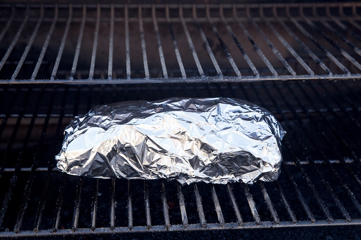 Double wrap the brisket in foil and smoke for another few hours