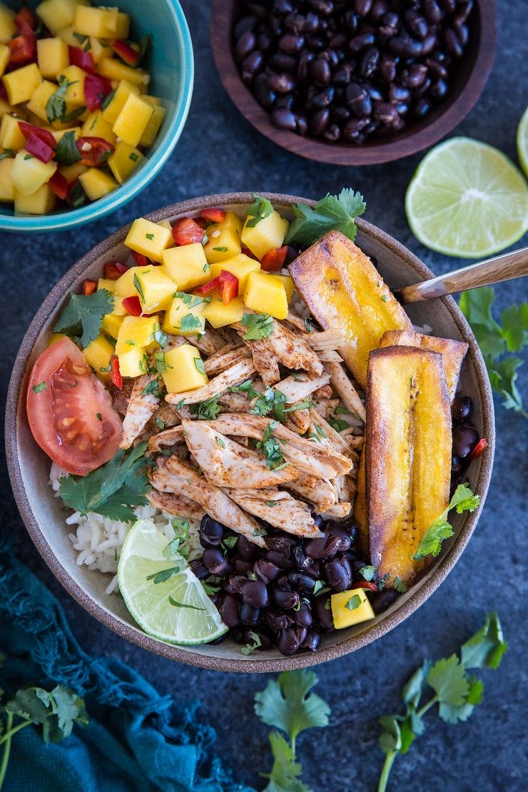 Jamaican Jerk Chicken Bowls with black beans, mango salsa, coconut rice, and fried plantains