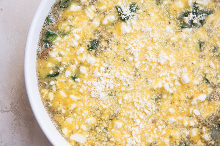 Sprinkle quiche with feta cheese