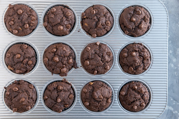 baked chocolate banana muffins in a muffin tray