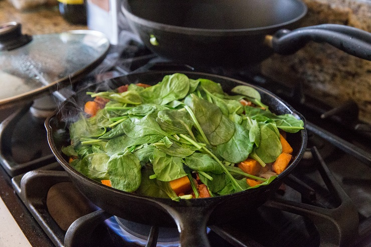 Cook the spinach into the hash