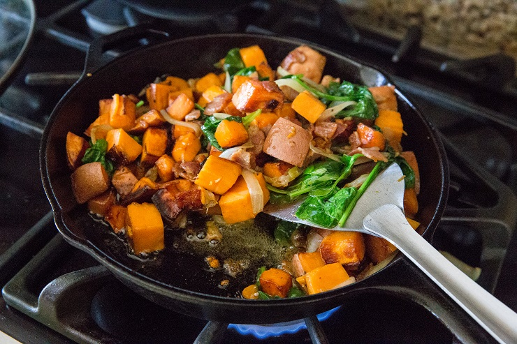 Stir the spinach into the hash and continue cooking until potatoes are cooked through