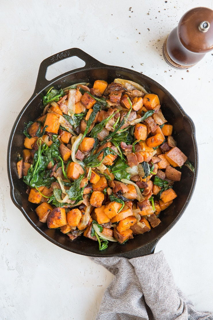 Sweet Potato Hash Recipe with bacon, onion, and spinach. This easy breakfast recipe results in perfectly crispy potatoes