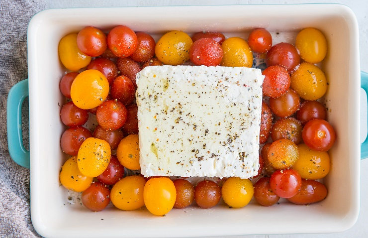 Add the feta cheese to the casserole dish and drizzle with avocado oil, sea salt, and pepper