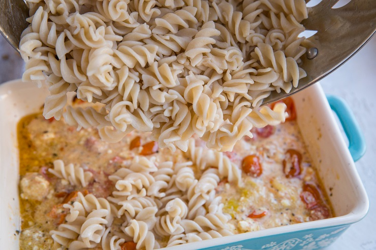 Pour the cooked noodles into the casserole dish with the sauce