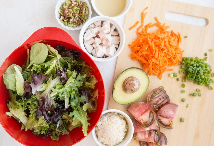 Ingredients for a delicious vegetable packed chicken salad with avocado