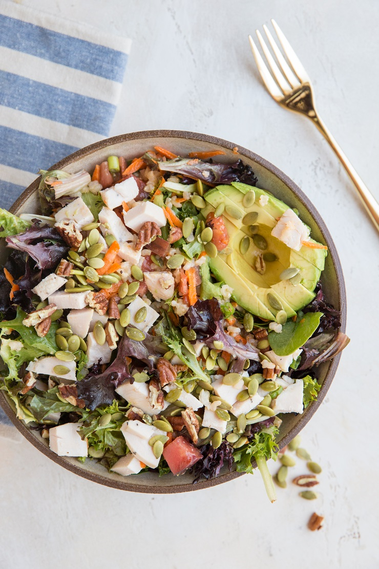 Fully Loaded Salad with chicken, avocado, pumpkin seeds, pecans, carrots, tomatoes, and more!