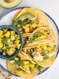 Easy Fish Tacos with Mango Salsa - fresh, delicious fish tacos made with baked cod. Super quick and delicious!