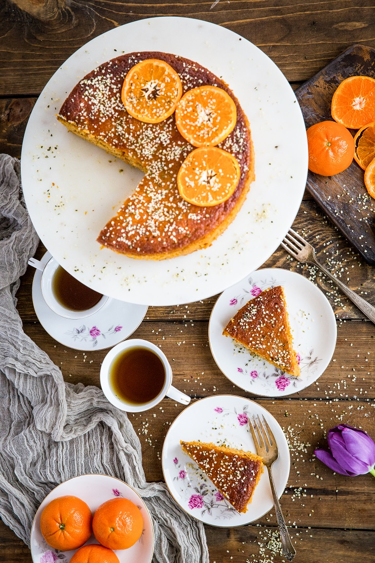 top down photo of clementine cake with two slices on two plates