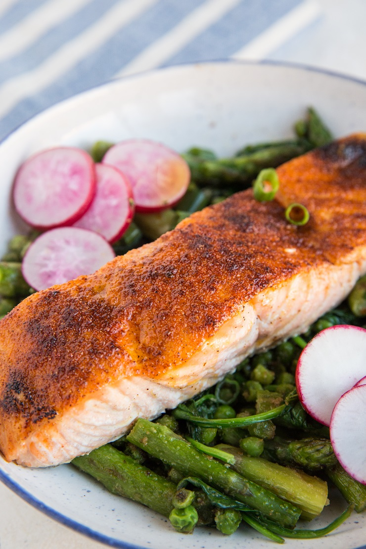 Spring Salmon Bowls with asparagus, peas, spinach, and radishes. A healthy, vibrant dinner recipe!