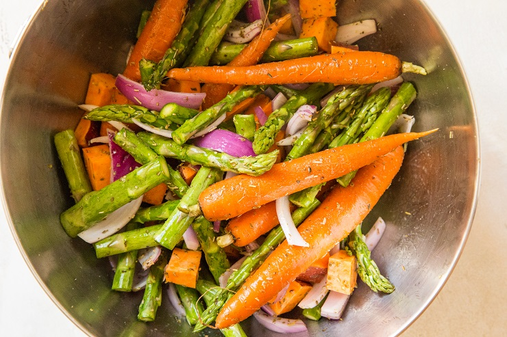 Mix vegetables in a mixing bowl with oil and seasoning