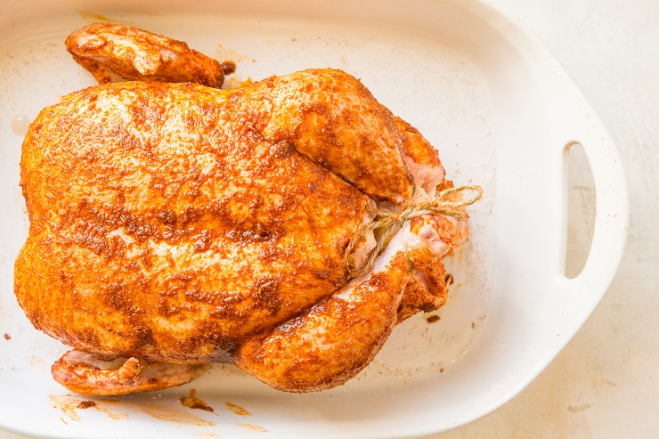 Rub the chicken marinade all over the whole chicken
