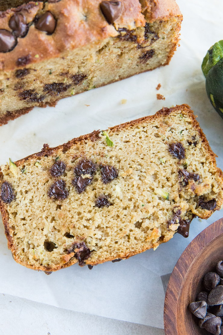 The BEST Almond Flour Zucchini Bread - grain-free, dairy-free, refined sugar-free, INSANELY moist and fluffy. Bake a loaf of this chocolate chip studded bliss every week!