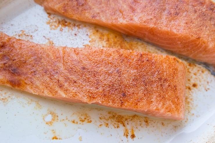 Season salmon with avocado oil, sea salt, paprika and garlic powder