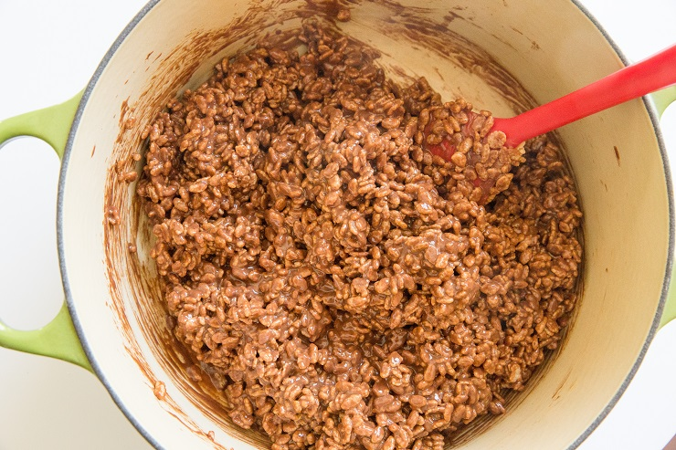 Ingredients for peanut butter no bake cookies stirred in a pot