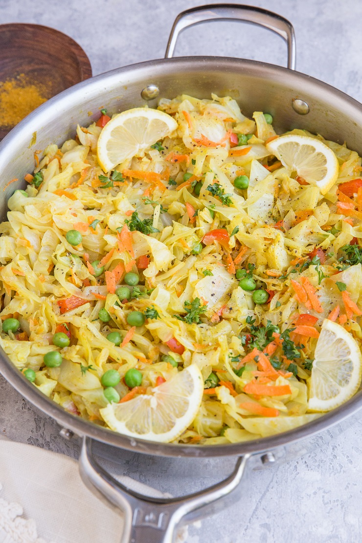 Curry Sautéed Cabbage with peas, carrots, and curry powder for an amazing side dish. Paleo, Vegan, whole30 and low-carb