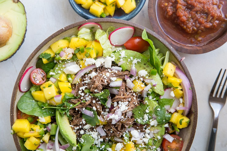 Instant Pot Shredded Beef Taco Salad with mango salsa, avocado and more! A healthy, satisfying entrée salad recipe.