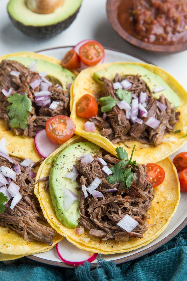 Instant Pot Shredded Beef Tacos - an easy beef taco recipe made in the pressure cooker. Perfect for any time of the year!
