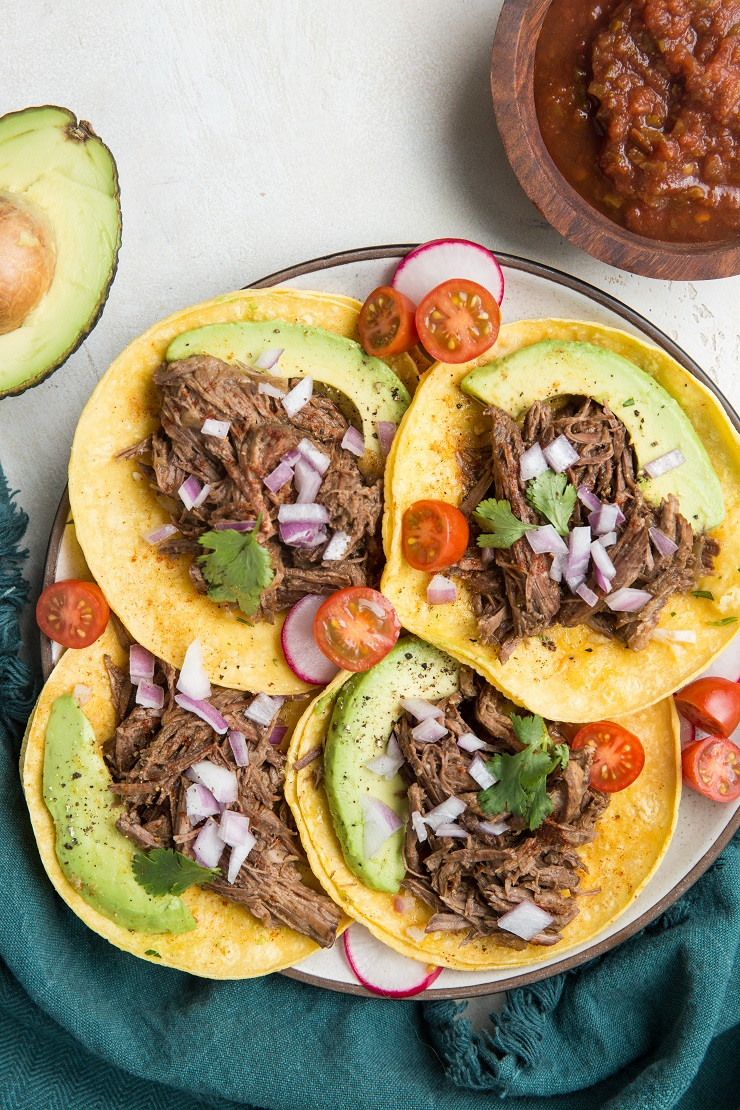Instant Pot Shredded Beef Tacos are a magically flavorful and clean taco recipe. Super easy to make in the Instant Pot!