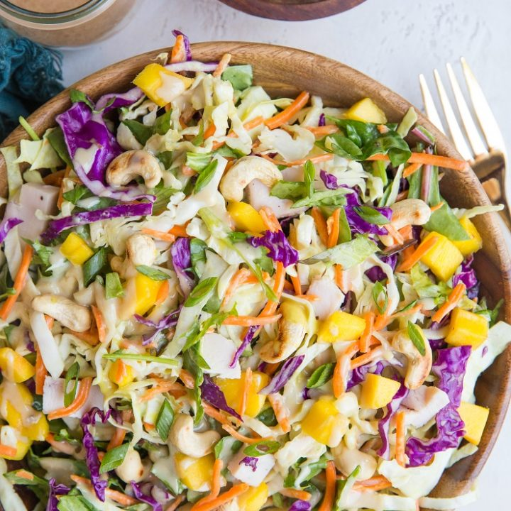 Thai Chicken Chopped Salad with peanut dressing and toasted cashews. Vibrant, delicious salad that is light yet satisfying.