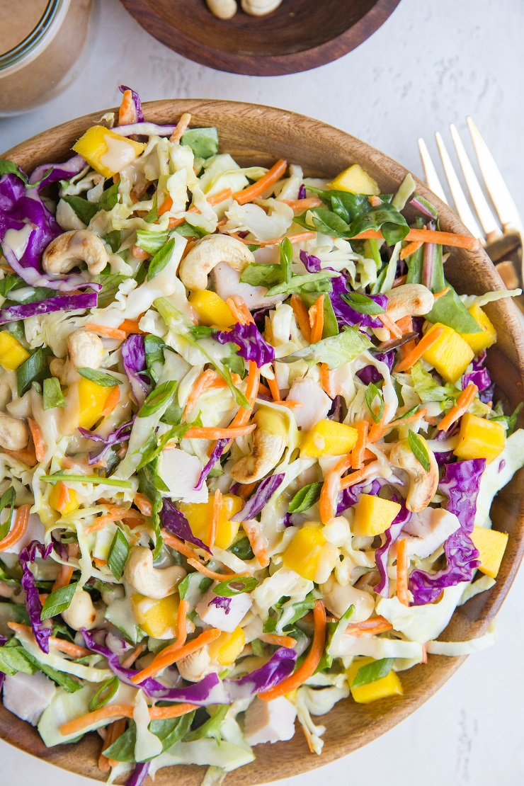 Thai Chicken Chopped Salad with cabbage, cashews, mango, and peanut dressing. A healthy, flavorful summer lunch or dinner.