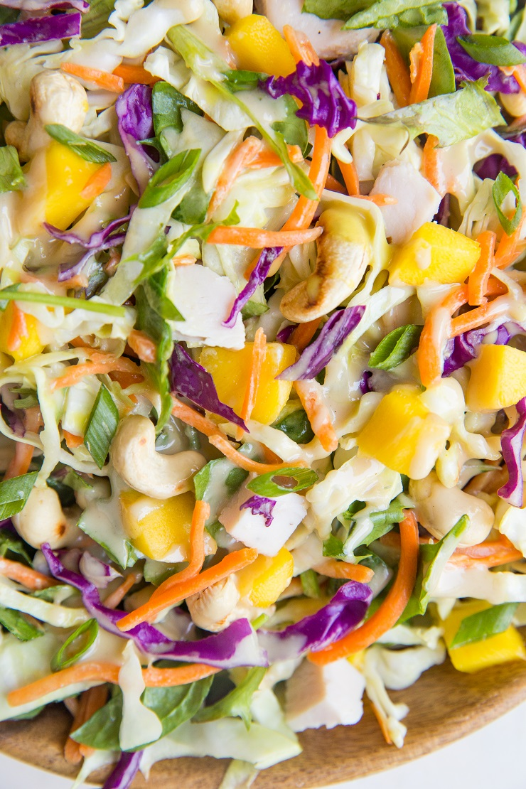 Thai Chicken Chopped Salad with cabbage, mango, and peanut dressing. A delicious, light yet filling salad recipe!
