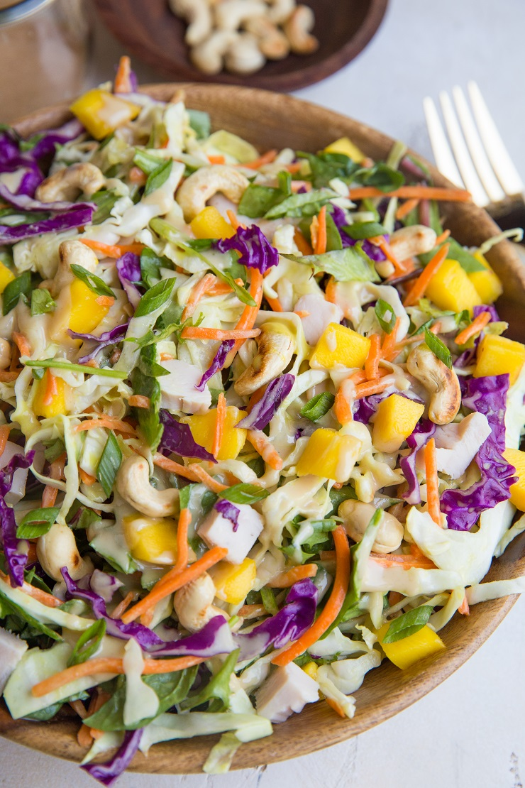 Thai Chicken Chopped Salad with cabbage, mango, and peanut dressing. A delicious, light yet filling salad recipe perfect for lunch or dinner.