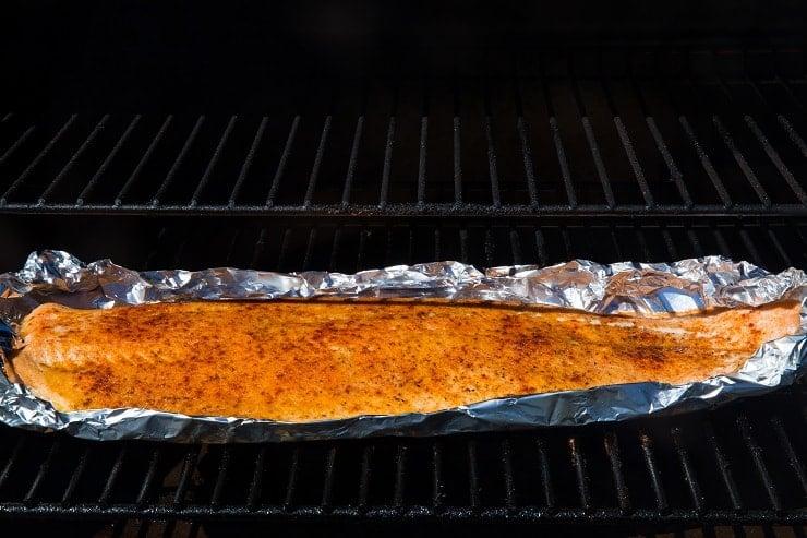 Salmon smoking on a smoker