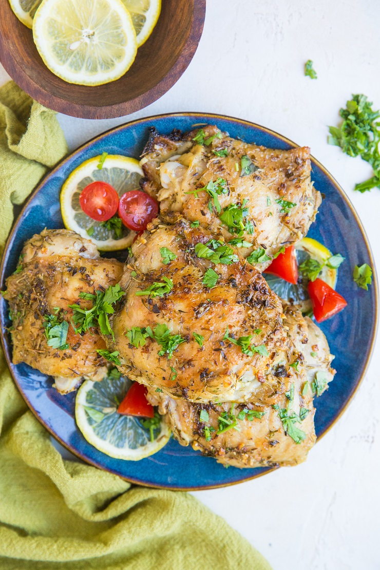 Greek Chicken recipe with a fresh lemon herb marinade. Tasty baked chicken ideal for weeknight meals or meal prep.