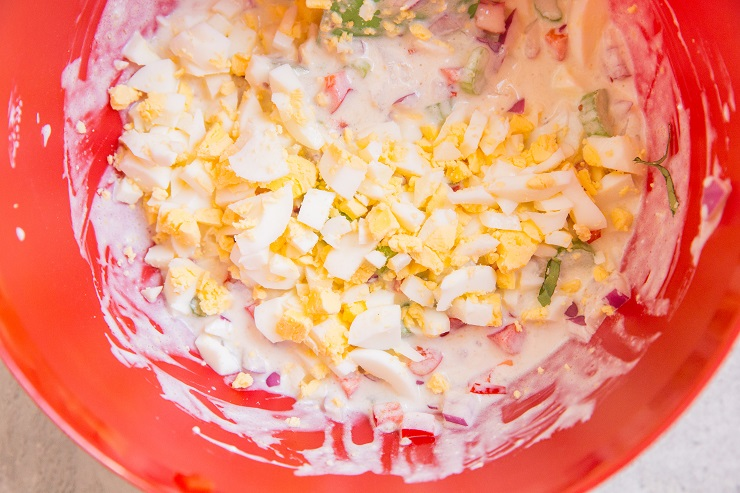 Ingredients for macaroni salad in a mixing bowl