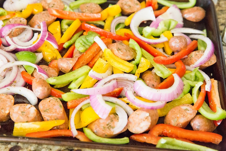 Sheet pan with sausage, peppers, and onions