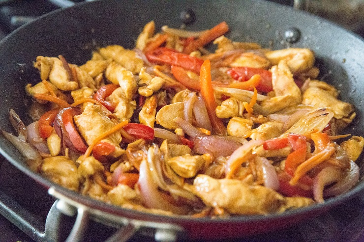 Add the stir fry vegetables back into the skillet with the chicken