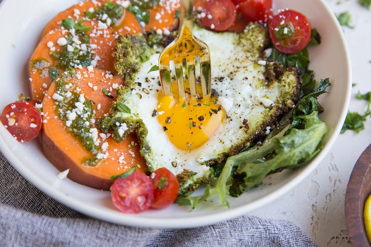 Pesto Eggs Breakfast Bowls with sweet potato, greens, cherry tomatoes and feta is a delicious and nourishing way to start the day!