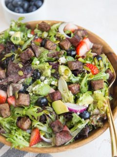 Easy Steak Salad with Berries, Avocado, Green Goddess Dressing, Feta, Green Onion, Pumpkin Seeds, and more! A marvelously refreshing summer salad recipe
