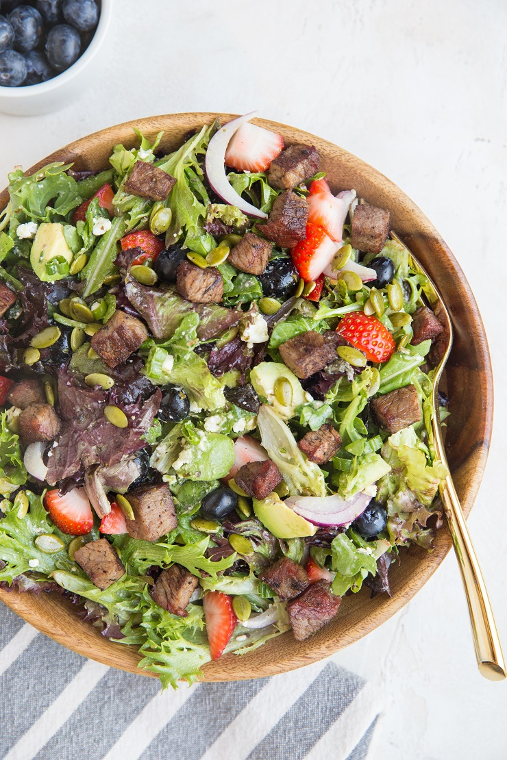 Steak Salad with Berries, Avocado, Feta, Red Onion, Pumpkin Seeds, and Goddess Dressing - a delicious summer dinner recipe!