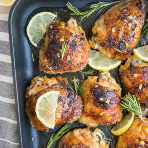 Easy Baked Garlic Lemon Rosemary Chicken - fall-off-the-bone tender delicious chicken thighs with perfect crispy skin - a simple yet magnificently flavorful dinner
