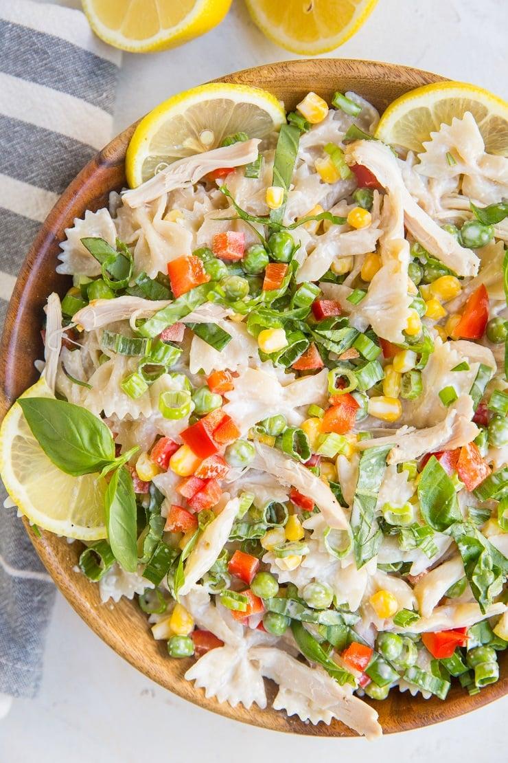 Easy Creamy Chicken Pasta Salad with peas, corn, bell pepper and Lemon Greek yogurt dressing. Light, refreshing, delicious!