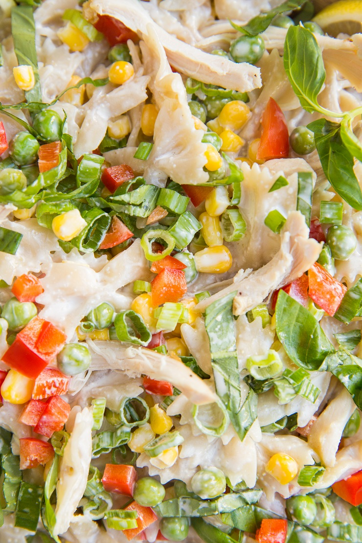 Creamy mayo-free Chicken Pasta Salad with corn, bell pepper, peas, and a lemony Greek yogurt dressing. Light and refreshing