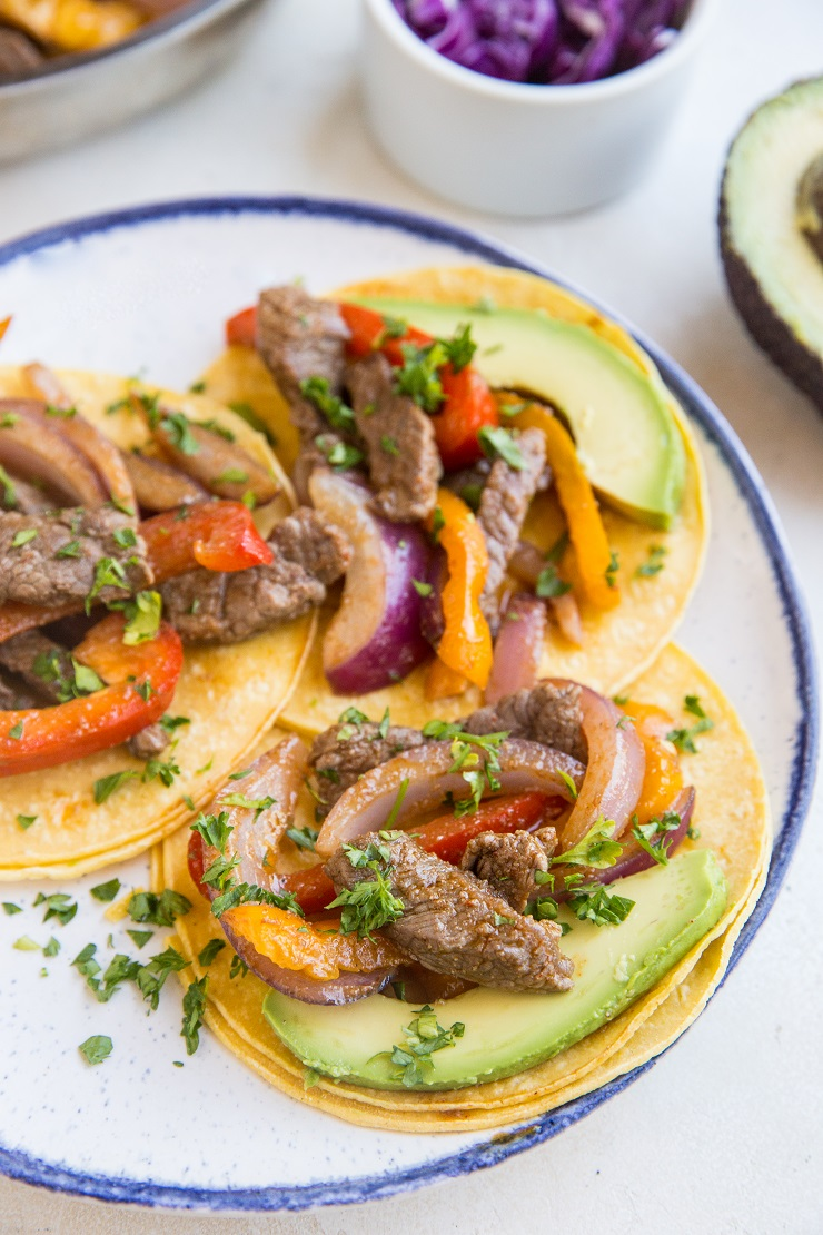 Quick & Easy Steak Fajitas made with only a few basic ingredients. These incredibly flavorful fajitas can be used in tacos, burritos, burrito bowls, and more!