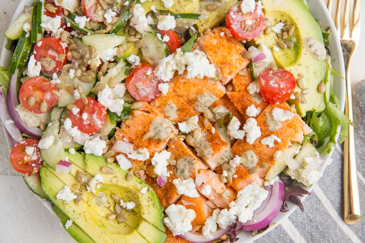 Greek Salmon Salad with feta, avocado, cucumber, tomatoes, red onion, and an herby dressing. This healthy satisfying salad recipe. Low-carb, keto and delicious for summer