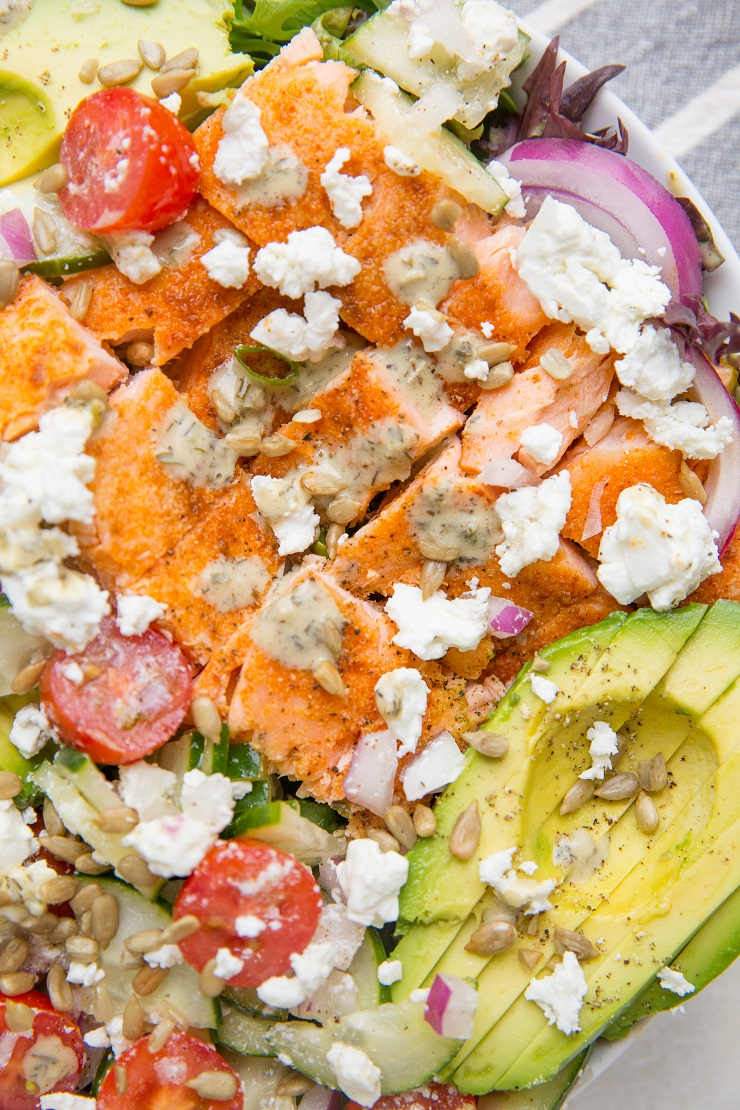 Greek Salmon Salad with cucumbers, avocado, red onion, feta, cherry tomatoes, and an herby dressing. This simple, nourishing recipe is loaded with fresh flavor and is low-carb keto friendly