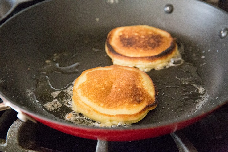 Cooking coconut flour keto pancakes on the stove top