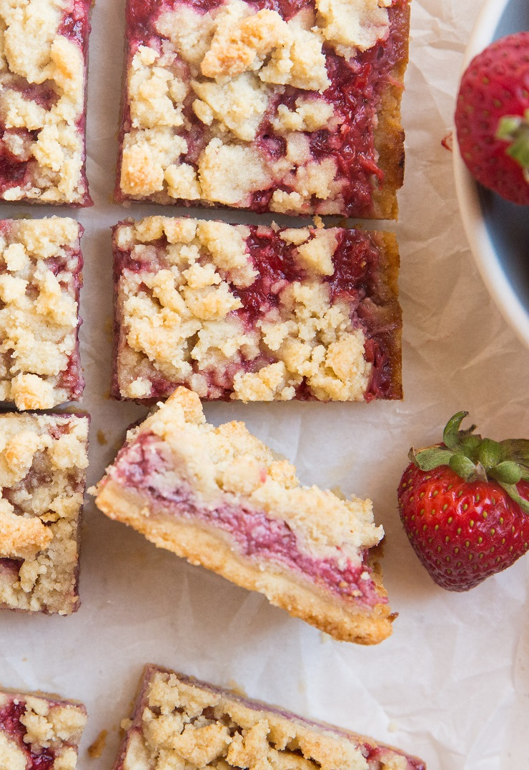 Beautifully buttery Keto Strawberry Crumb Bars on a grain-free shortbread crust are magically flaky with the perfect sweet, tangy gooey strawberry bite. This incredibly easy recipe only requires 5 basic ingredients! Egg-free and easy to make dairy-free for a vegan option!
