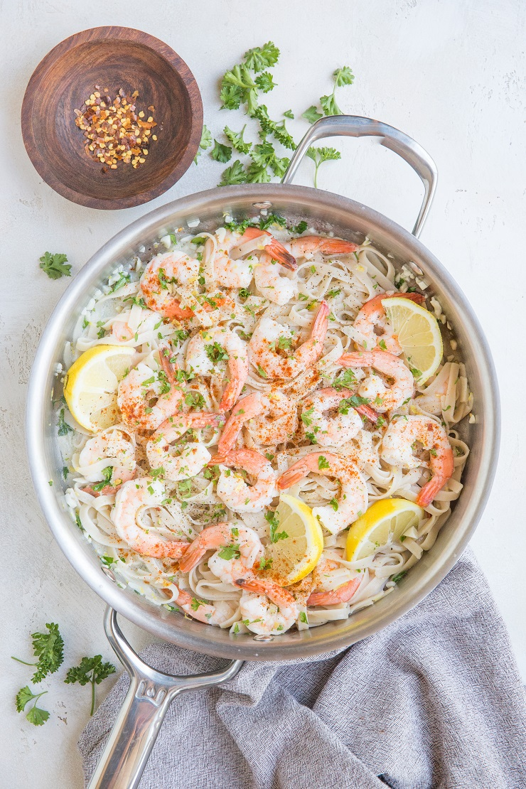 Easy Lemon Garlic Shrimp Pasta with a creamy dairy-free sauce. Zesty, creamy, garlicky PERFECT pasta for an amazing romantic meal!