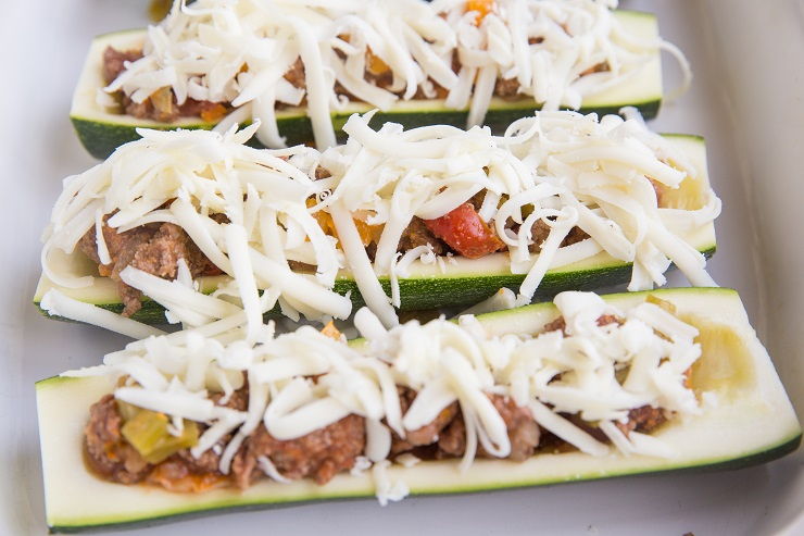 Stuff the zucchini with ground beef taco mixture and sprinkle with cheese